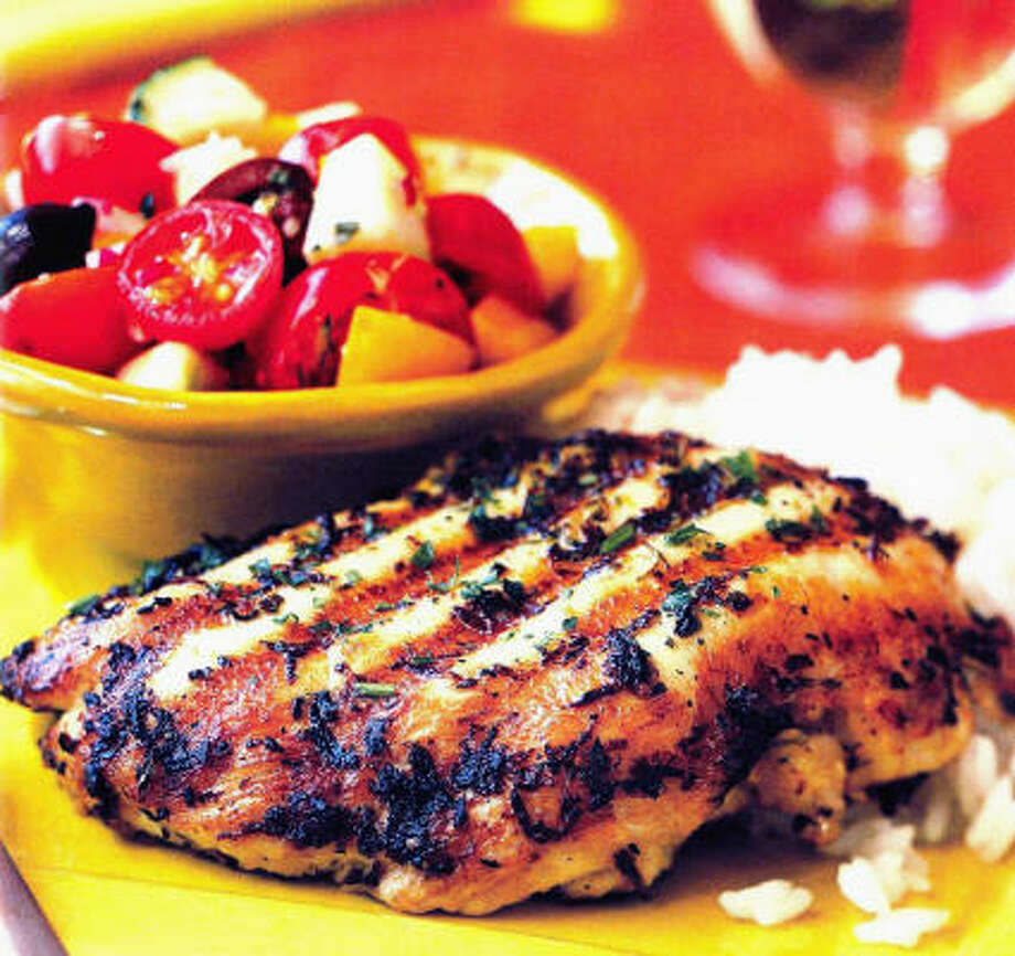 Chicken gets a flavorful rub of lemon rind, oregano and garlic before grilling. Photo: Associated Press