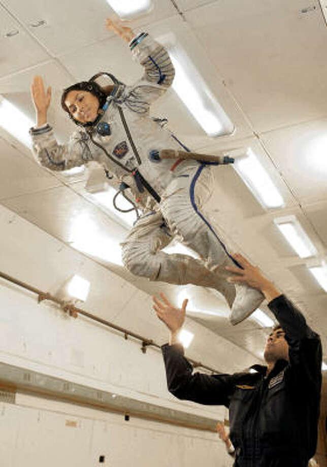Anousheh Ansari flies inside a zero-gravity simulator in Star City outside Moscow. Photo: AP