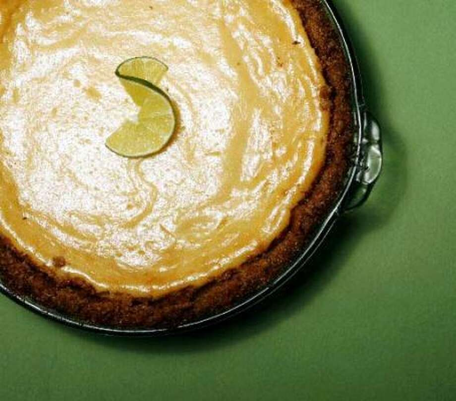 Lemons and limes have juicy roles in this recipe for Key lime pie. Photo: Billy Smith II, Chronicle