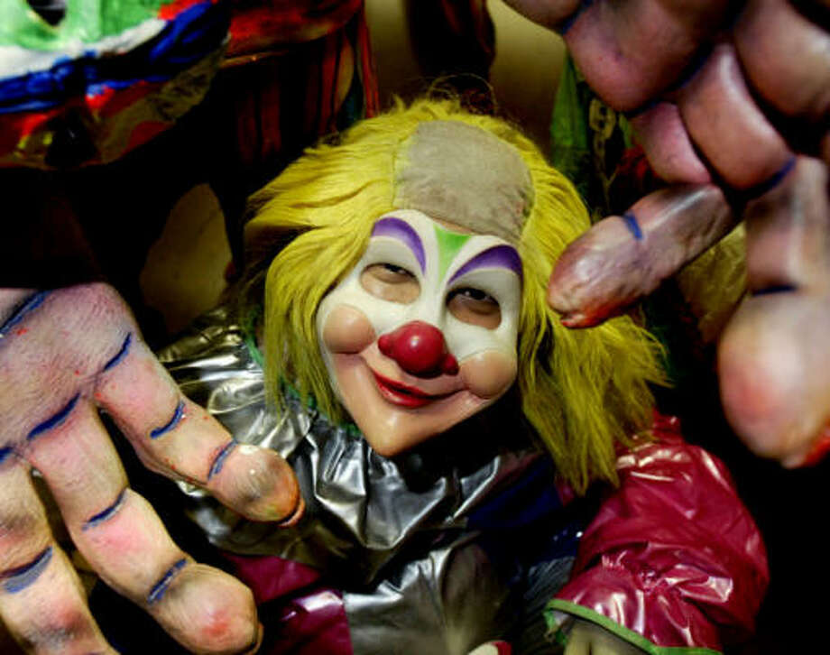 Not all the clowns at 3-D Clown Phobia are scary, but don't turn your back or they'll sneak up behind you. Photo: Jessica Kourkounis, For The Chronicle
