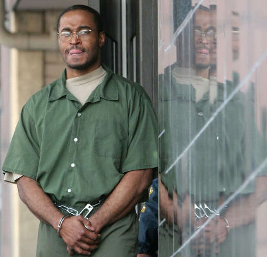 Tyrone Williams, seen here leaving the federal courthouse in Houston in March 2005, was indicted along with 13 other people in the deaths of 19 illegal immigrants. Photo: PAT SULLIVAN, AP File