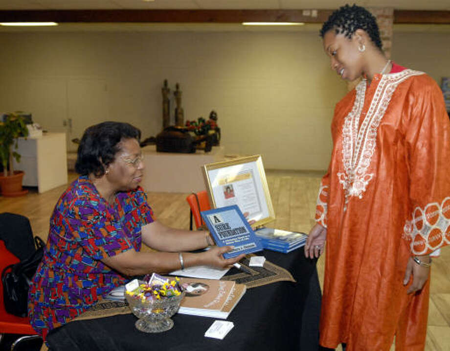 Fulshear author Barbara Chatam visits with Bianca Madison from the Shrine of the Black Madonna Cultural Center during a book signing at the center. Photo: KIM CHRISTENSEN, For The Chronicle