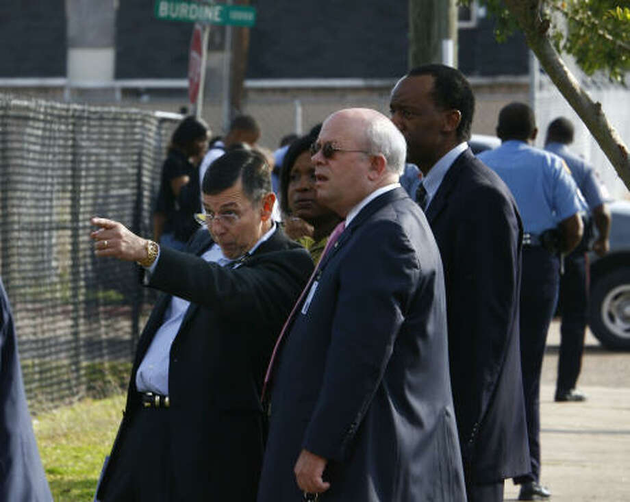 HISD Superintendent Abelardo Saavedra points during a conversation at the scene of the fatal shooting Tuesday. Police planned to interview at least nine witnesses to the shooting. Photo: Steve Ueckert, Chronicle