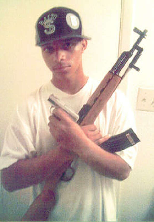 Photograph of Anthony Johnson found on him at the shooting. The photograph shows Johnson holding two weapons, one a handgun, the other, an assault rifle that sheriff's officials believe to be the one recovered at the scene. Photo: Harris County Sheriff's Office