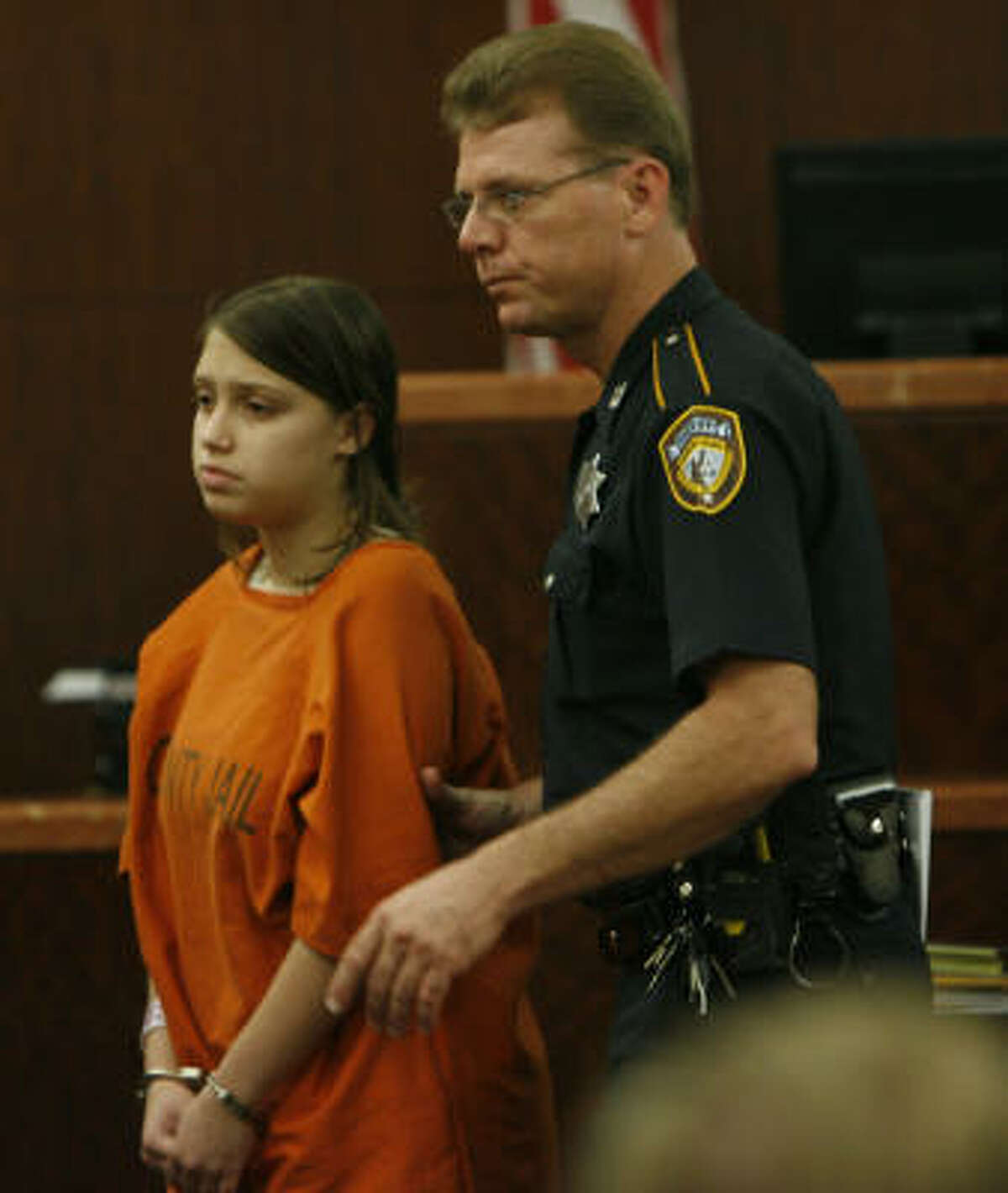 Ashley Paige Benton is escorted out of the courtroom by the bailiff after she appeared in court at the Harris County Criminal Justice Center in Houston.
