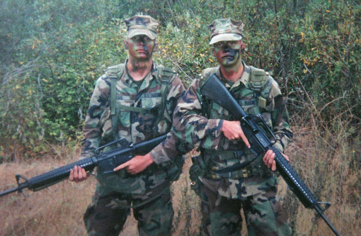 Twins Toby, left, and Matt Winn finished Infantry Training School for the Marines at Camp Pendleton, Calif., in 2001. The Winns are among thousands who could be called back to active service.