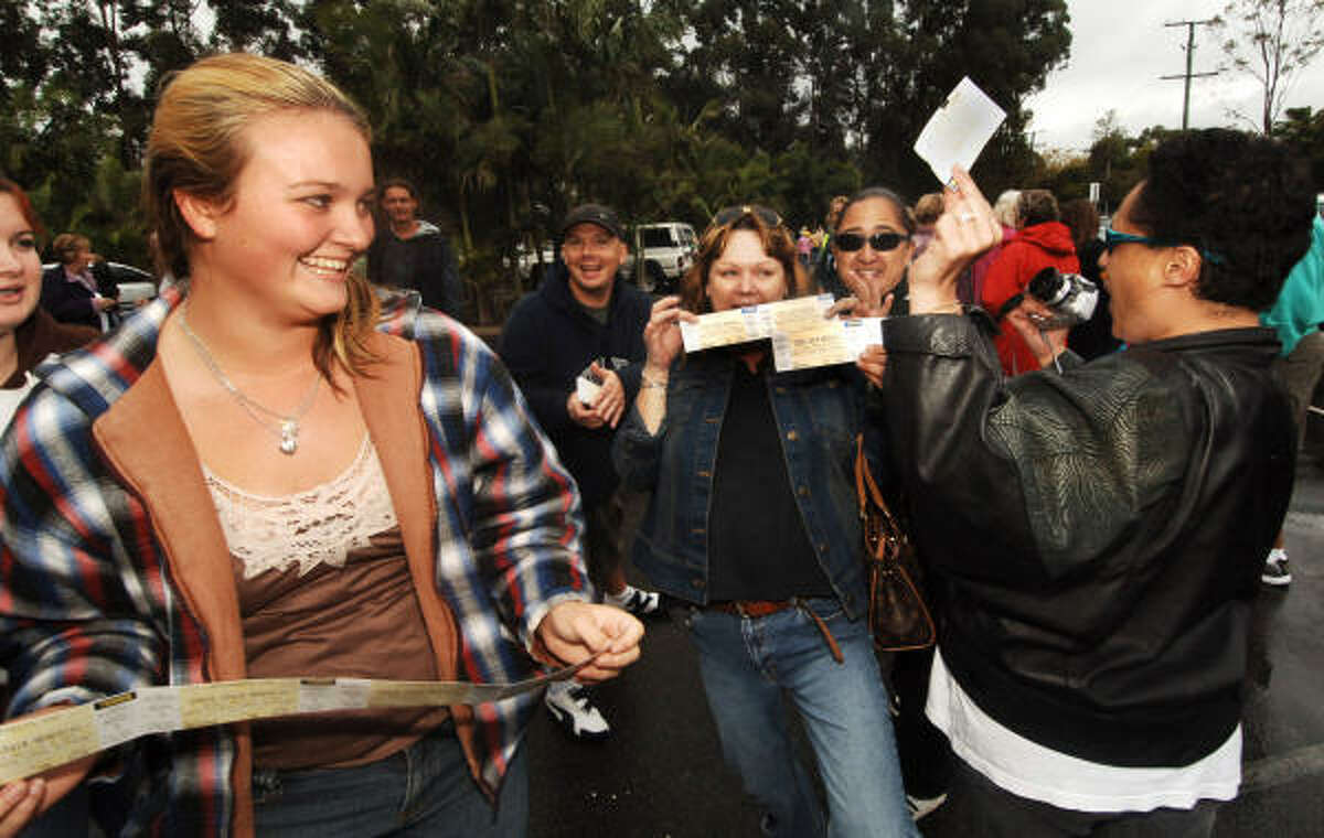 Fans of the late Steve Irwin celebrate Sept. 15 after being allocated free tickets to a memorial service at his Australia Zoo, near Brisbane, Australia.