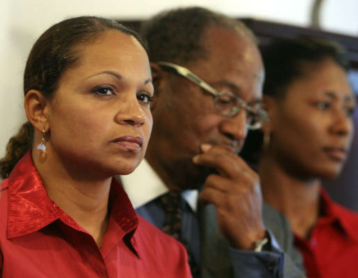 Joslyn Johnson, left, widow of fallen HPD officer Rodney Johnson, urges calm after threatening calls were received at LULAC's office Tuesday.