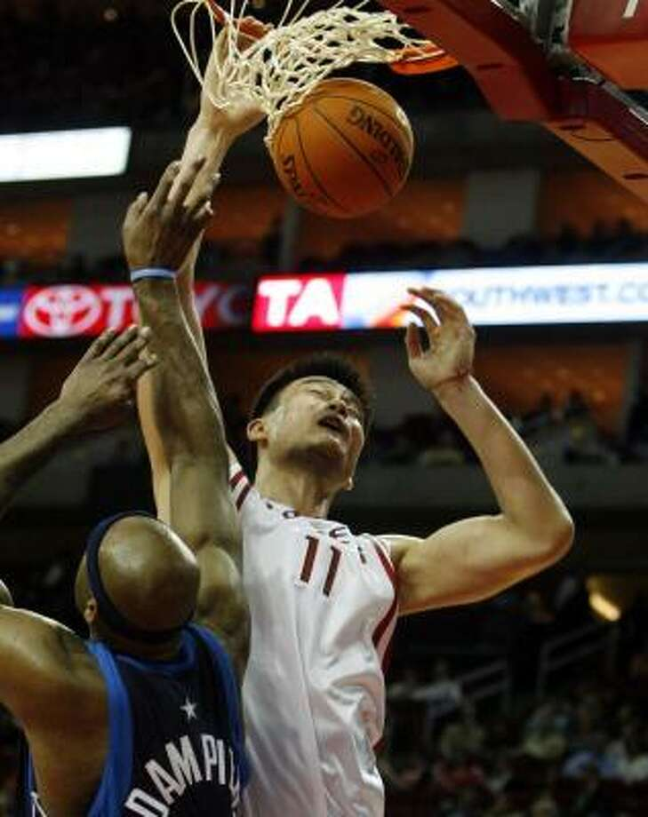 """One game after playing like what coach Jeff Van Gundy called """"willow trees,"""" Yao Ming (11) and the Rockets dominated the Mavericks. Photo: Billy Smith II, CHRONICLE"""