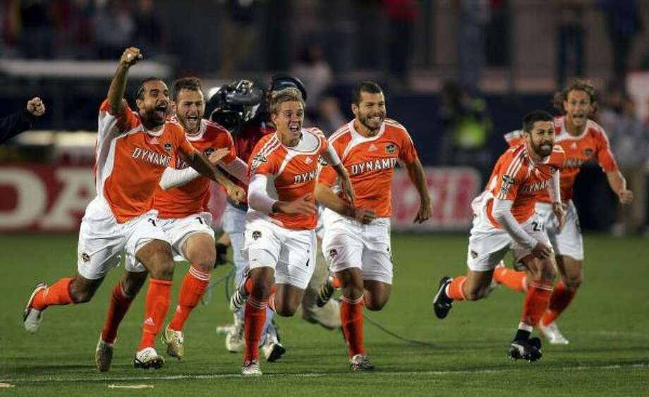 The Dynamo's Stuart Holden, third from left, got a taste of big-game soccer back in August, which helped prepare him for what came later with the MLS Cup. Photo: Ronald Martinez, Getty Images
