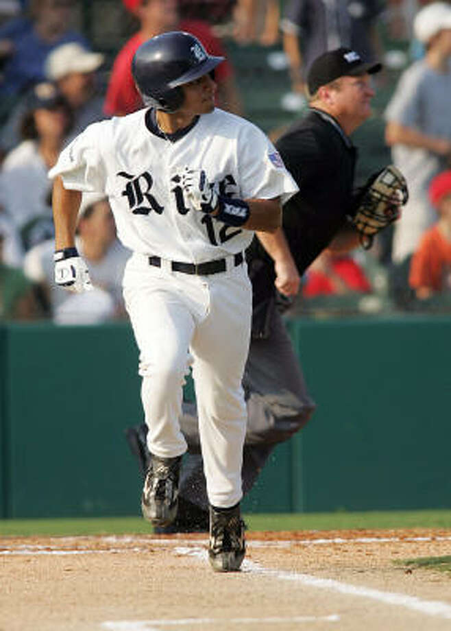Rice's Josh Rodriguez watches his home run clear the fence in the first inning. Photo: JAMES NIELSEN, CHRONICLE