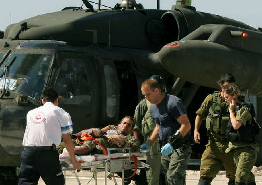 An Israeli soldier injured in an attack by Hezbollah guerrillas  in northern Israel on the border with Lebanon is evacuated from a helicopter to a hospital in Haifa, northern Israel, today. Photo: ELAD GERSHGORN, AP
