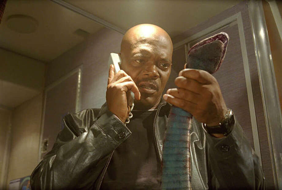Neville Flynn (Samuel L. Jackson) is stuck over the ocean on a plane full of snakes, in Snakes On A Plane. Photo: James Dittiger, New Line Productions