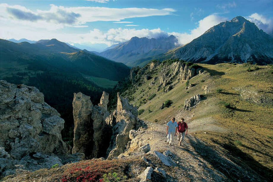 Hikers walk near Ofen Pass in Switzerland, voted Europe's best country for scenery by tour operators. Photo: Robert Boesch, Switzerland Tourism