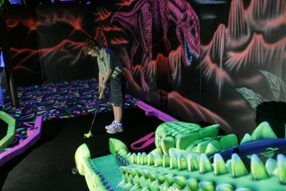 Actor Andrew Gillingham tries his hand at black-light miniature golf at Shankz in The Woodlands. His film, How to Eat Fried Worms, opens Aug. 25. Photo: Steve Campbell, Houston Chronicle