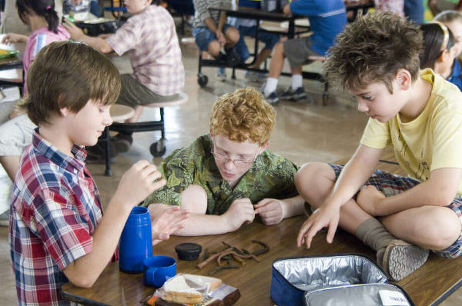 Billy (Luke Benward, left) Techno Mouth (Andrew Gillingham) and Twitch (Alexander Gould, right) plan strategy in How to Eat Fried Worms. Photo: Van Redin, New Line