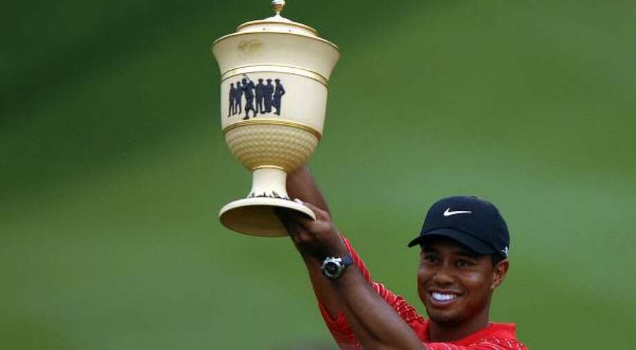 Tiger Woods holds the Gary Player Cup after winning the Bridgestone Invitational. Photo: Montana Pritchard, Getty Images