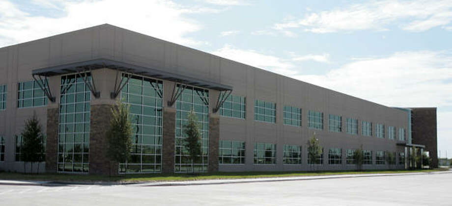 Men's Wearhouse, a national clothing retailer, will take over 130,112 square feet, or 63 percent, of the energy-efficient office building at Oak Park Center II in Westchase. Photo: Billy Smith II, CHRONICLE
