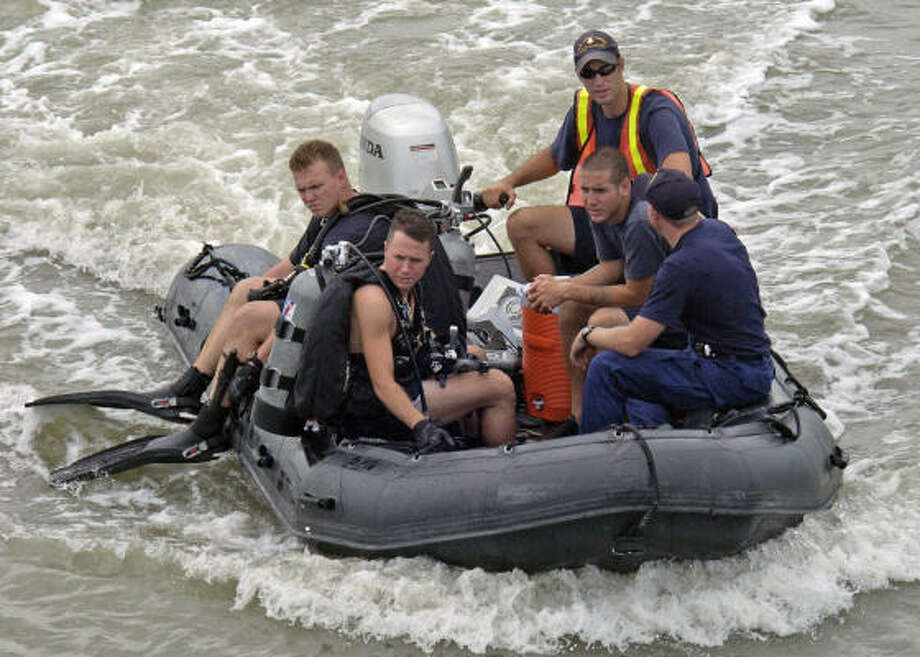 Members of a Coast Guard dive squad based in Galveston prepare to conduct a bomb sweep of a pier during a full-scale drill last week. The Coast Guard patrols oversees all marine operations in the area. Photo: Adam Eggers, U.S. COAST GUARD