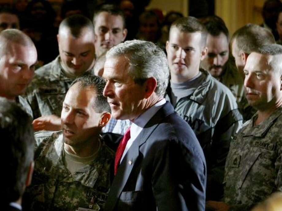 President Bush is surrounded by military personnel after remarks Tuesday to the Military Officers Association of America. Photo: JIM YOUNG, REUTERS