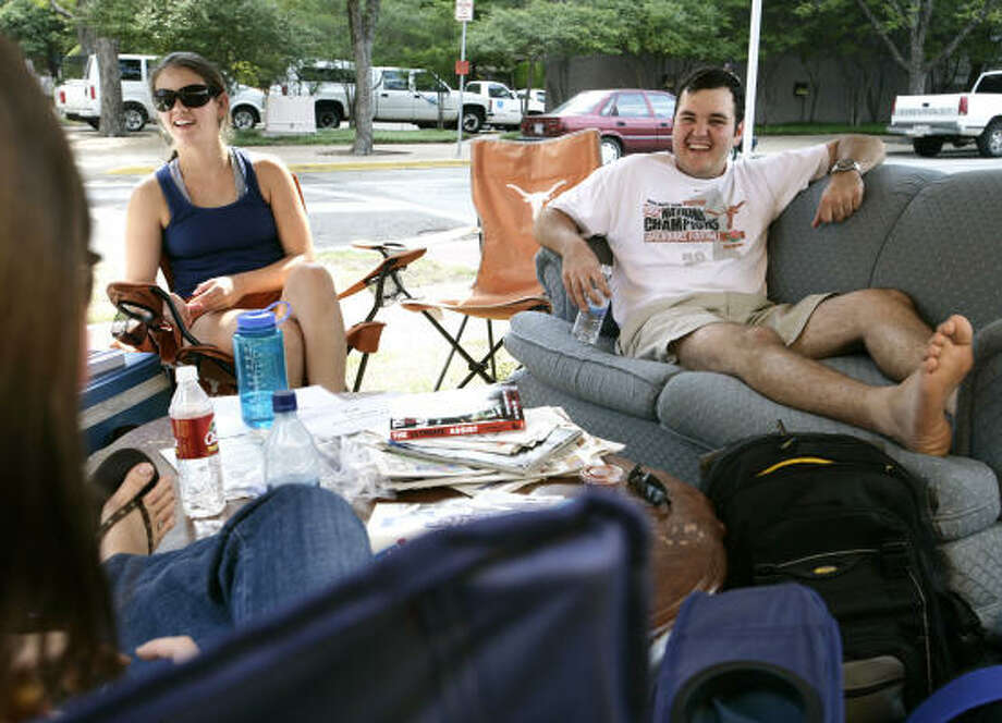 UT fans Jade Eason, left, and Adam Bielamowicz camp out Thurday while waiting for parking lots to open Friday. Photo: Taylor Jones, For The Chronicle
