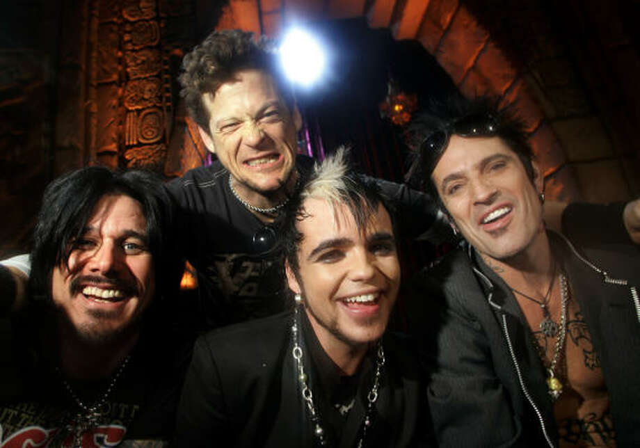 Lukas Rossi, of Canada, center, poses with his new band, comprised of Gilby Clarke, left, Jason Newsted, top, and Tommy Lee, right, after winning Rock Star: Supernova. Photo: DANNY MOLOSHOK, Associated Press