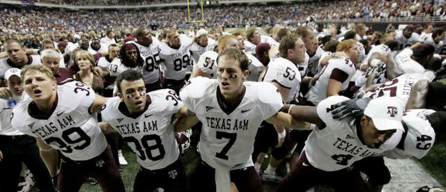 Texas A&M QB Stephen McGee (7) celebrates with teammates after defeating Army 28-24. Photo: Eric Gay, AP