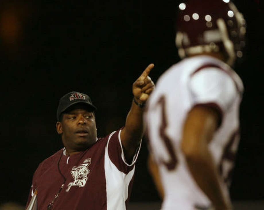 TSU head football coach Steve Wilson runs his team through practice Tuesday night. Photo: Kevin Fujii, Houston Chronicle