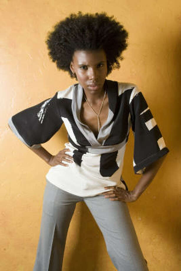 Hip Dolman sleeves and graphic patter make a Borne blouse, $207, special. It's from Raye, along with Borne Norfolk trousers, $292, necklace, $295, earrings and rings. Photo: BRETT COOMER, CHRONICLE