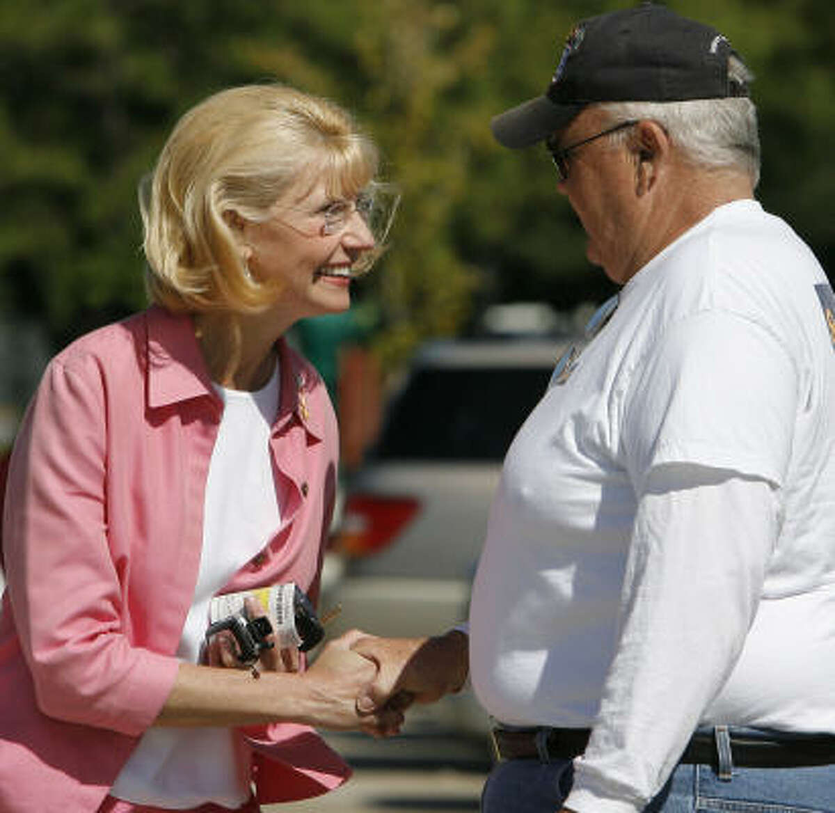 Congressional candidate Shelley Sekula Gibbs, left, talks with one of her volunteers, Bob Meaney after taking advantage of early voting at the Freeman's Branch Library in Clear Lake, Texas.