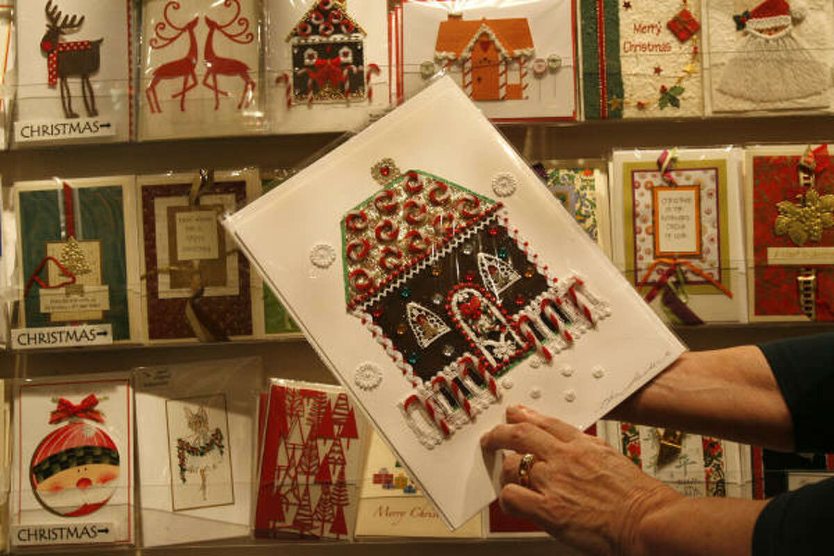 Donna Milstein, co-owner of Hanson Galleries, holds a handcrafted holiday card. The National Retail Federation expects a 5 percent increase in sales for this holiday season, compared to 6.1 percent for 2005.