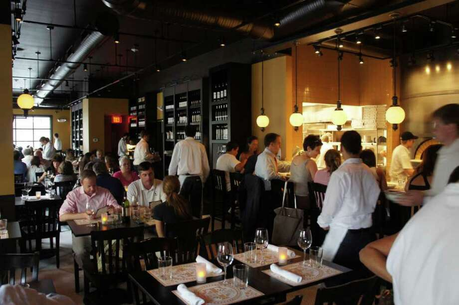 The scene at the new Tarry Lodge Enoteca Pizzeria, which celebrity chef Mario Batali and partners opened this week on Charles Street. Photo: Paul Schott / Westport News