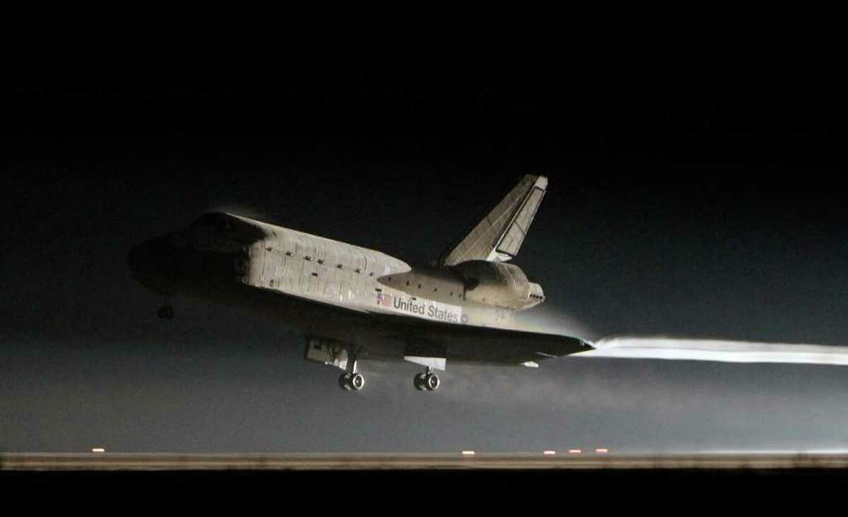 Space shuttle Atlantis lands at the Kennedy Space Center in Cape Canaveral, Fla., Thursday, July 21, 2011. The landing of Atlantis brings the space shuttle program to an end. (AP Photo/John Raoux)