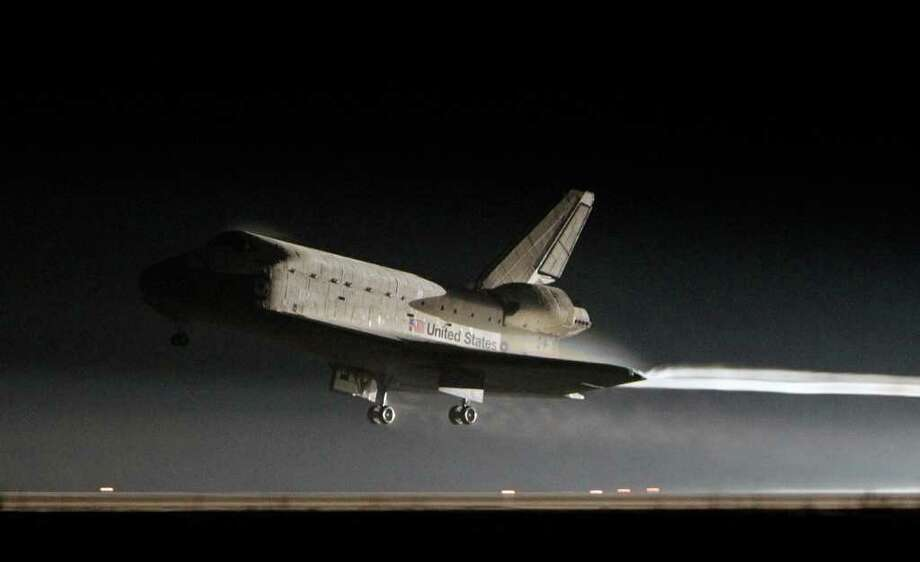 Space shuttle Atlantis lands at the Kennedy Space Center in Cape Canaveral, Fla., Thursday, July 21, 2011.  The landing of Atlantis brings the space shuttle program to an end. (AP Photo/John Raoux) Photo: John Raoux, ASSOCIATED PRESS / AP2011