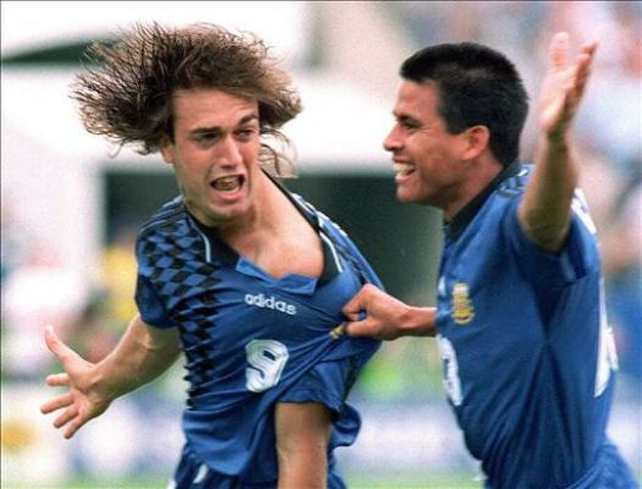 Argentinian striker Gabriele Batistuta (L) celebrates with teammate Fernando Caceres after scoring an early goal during the World Cup first round soccer match against Greece 21 June 1994 in Boston. Batistuta scored two more goals to help his team beat Greece 4-0. Photo: DANIEL GARCIA, AFP