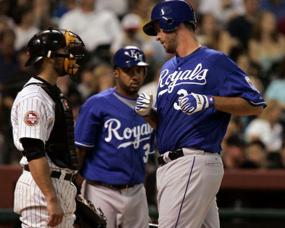 Royals' Scott Elarton, right, scores on a Reggie Sanders double as Astros' catcher Eric Munson, left, and Royals' Emil Brown look on in the fifth inning. Photo: PAT SULLIVAN, ASSOCIATED PRESS