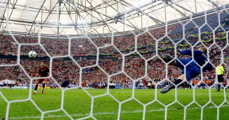 Cristiano Ronaldo scores the winning penalty during Portugal's 3-1 World Cup quarterfinal victory Saturday against England. Photo: ROSS KINNAIRD, GETTY IMAGES