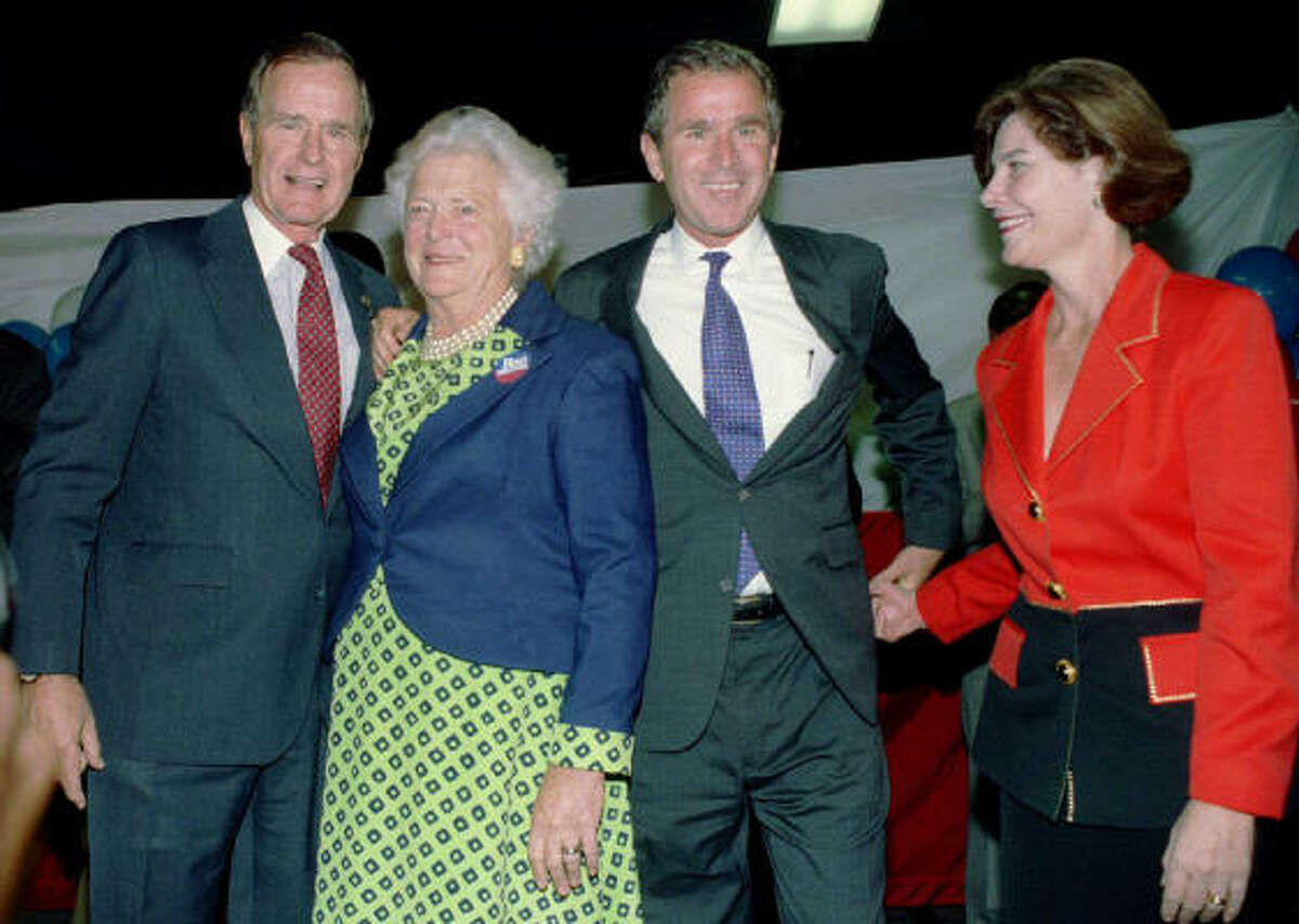 George and Barbara Bush join George W. Bush and his wife, Laura, during a rally in downtown Houston in November 1994, when the younger Bush ran against and defeated incumbent Ann Richards for governor.