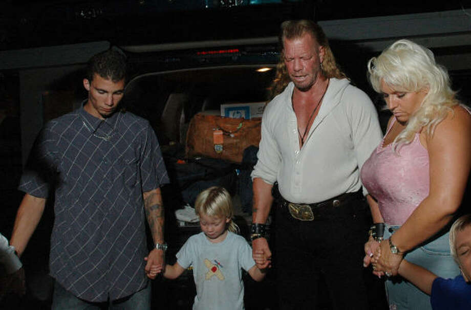 "Beth and Duane ""Dog"" Chapman, white shirt, pray with their family as they prepare for a trip to the East Coast for a series of scheduled appearances. A judge agreed to temporarily free Chapman, out on bail while international criminal charges are pending, and remove his electronic monitoring ankle bracelet. Photo: LUCY PEMONI, AP"