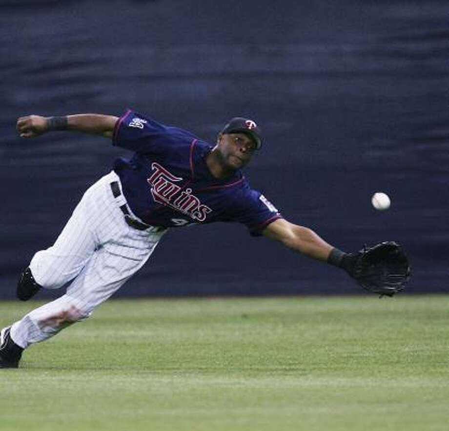 Torii Hunter's miss turned into an inside-the-park home run. Photo: Jonathan Daniel, Getty Images