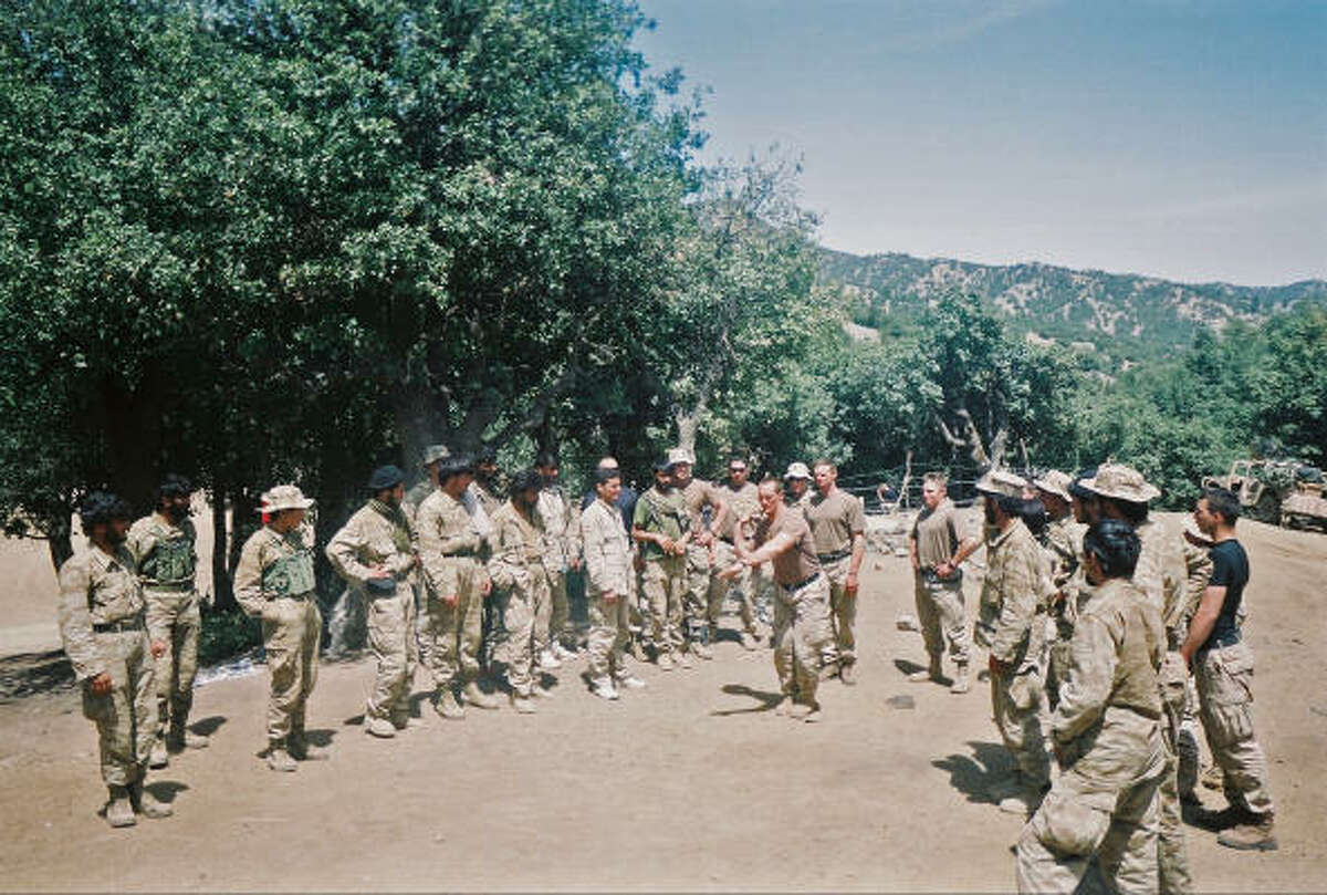 Army Ranger Pat Tillman demonstrates rock-throwing to soldiers in Afghanistan.