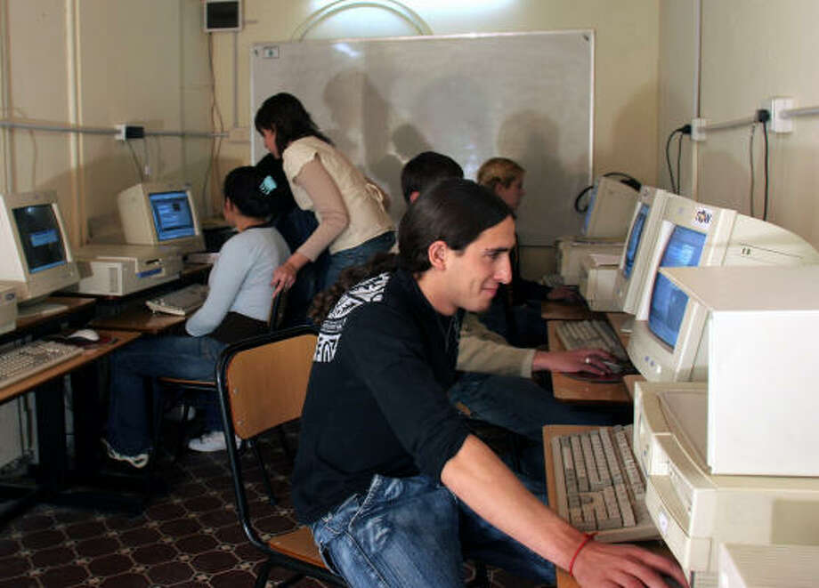 Students at Tigre Islas' school finally have a chance to experience the Internet Age thanks to an educational program that is boosting digital literacy in Argentina. Photo: ALI BURAFI, AP