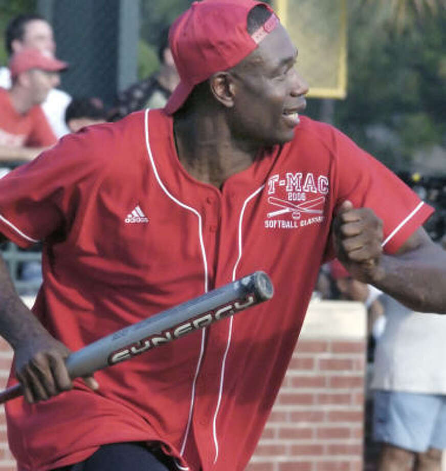 Dikembe Mutombo (shown at Tracy McGrady's charity softball game) has caused a number of NBA opponents to miss considerable time with injuries. Photo: TIM JOHNSON, CHRONICLE