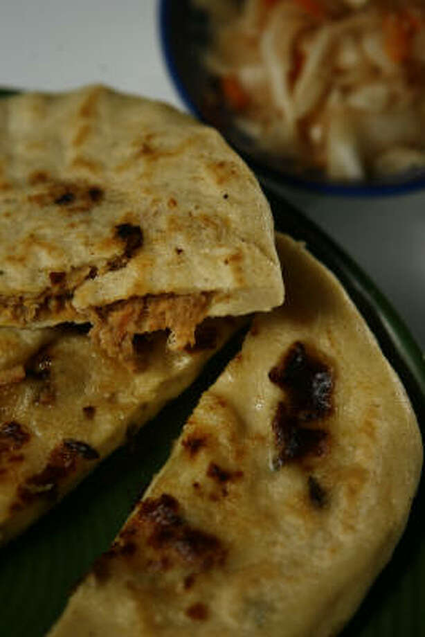 Pupusas are a specialty from El Salvador. These meat and cheese filled tortillas are from El Pupusodromo and can be found on 6817 Bissonnet. Photo: Nick De La Torre, CHRONICLE