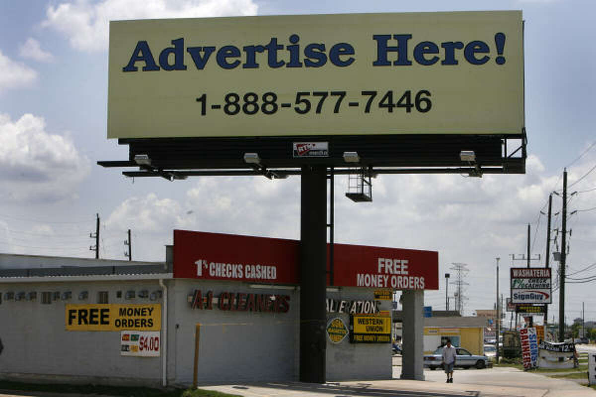 """This billboard at 11204 Veterans Memorial is one of many big signs erected in neighborhoods surrounding the city of Houston. Enforcing codes is """"a battle we want to try and win,"""" says Elizabeth Poole, a Houston city attorney."""