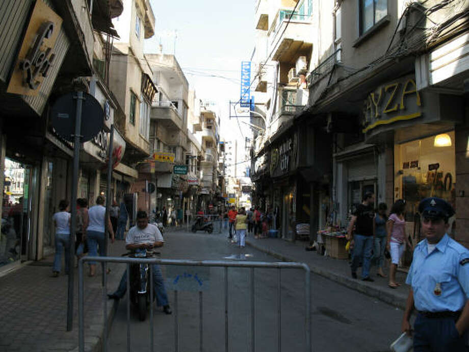 Lebanese police officer Rafi Bogosian stands in front of a busy street in Bourj Hammoud, an Armenian enclave on the outskirts of greater Beirut. He says he is opposed to the deployment of Turkish peacekeeping troops inside Lebanon because of Turkey's role in the mass murder of Armenians. Photo: Gregory Katz, Chronicle