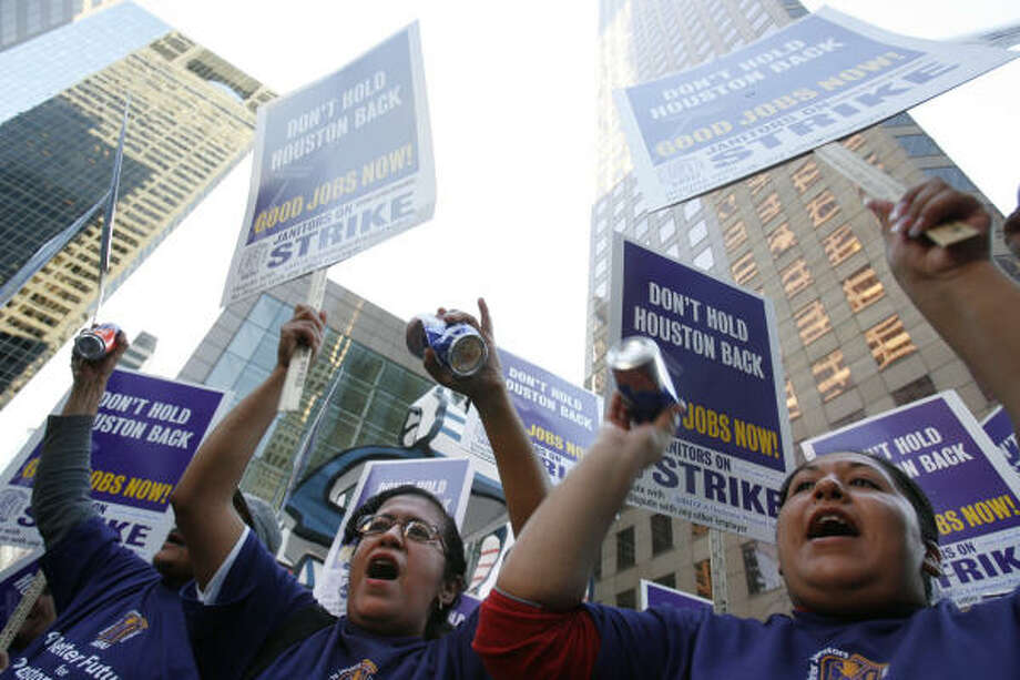 Catalina Perez, left, and Minerva Salas were among about 500 janitors and supporters to marched through downtown on Monday evening in support of the Service Employees International Union strike. Photo: SHARÓN STEINMANN, Chronicle