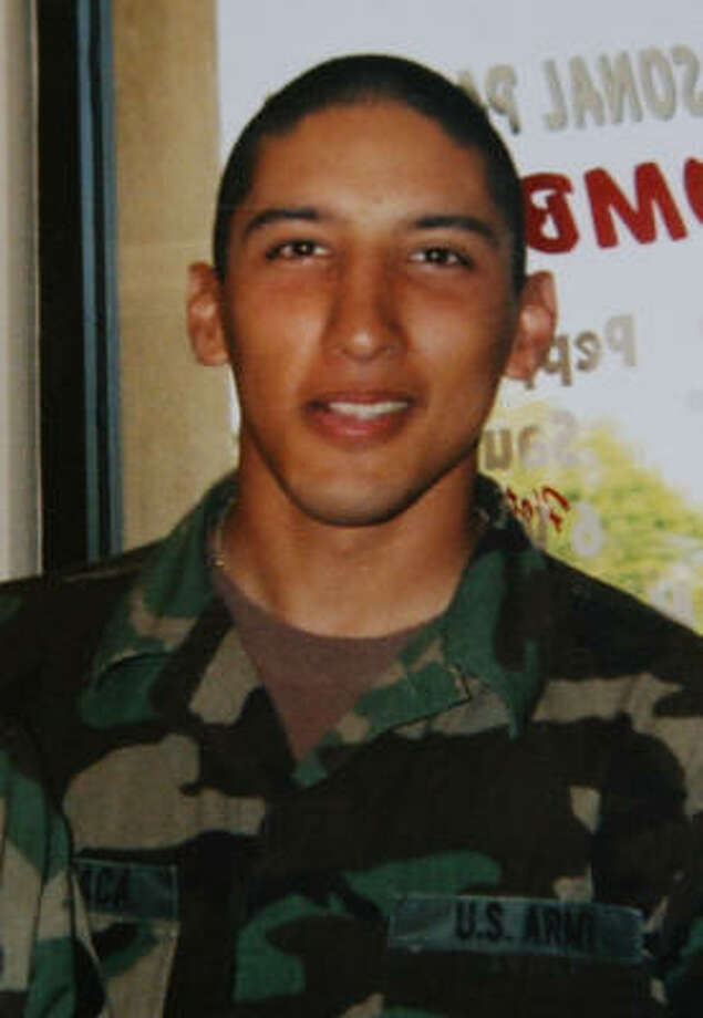 A copy of a family photo taken in December 2004 of Houston soldier Kristian Menchaca, 23. Photo: Sharon Steinmann, Chronicle