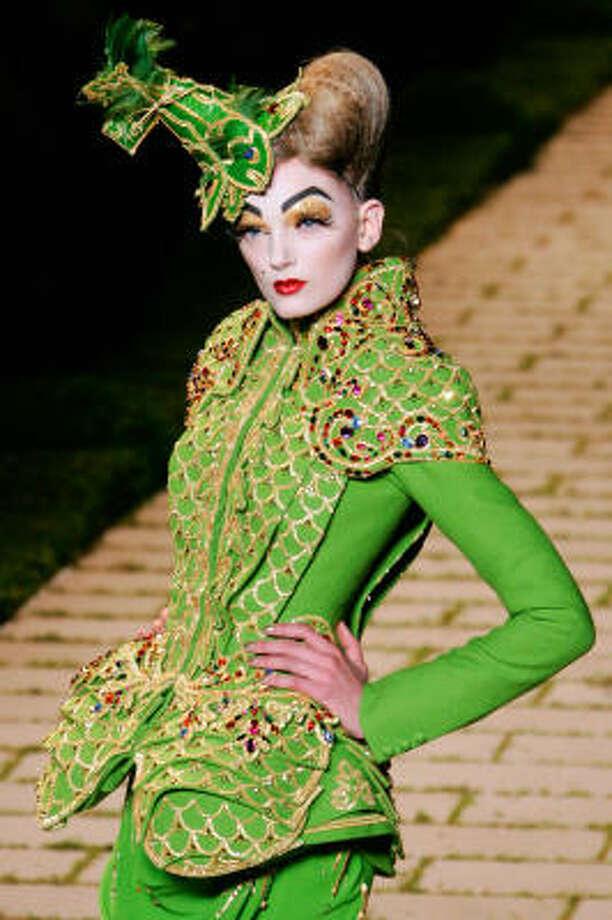 Christian Dior designer John Galliano was inspired by French director Marcel Carne's 1942 film Les Visiteurs du Soir (The Devil's Envoys), a fantasy tale set in the 15th century. Photo: FRANCOIS MORI, Associated Press