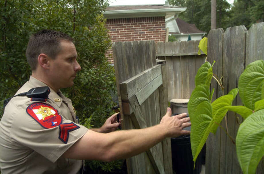 Montgomery County Sheriff Cpl. Donald Golsby secures a home after a house alarm call in The Woodlands on July 14.  Golsby said even though Montgomery County is one of the fastest growing counties in the state, additional officers haven't been added to adjust for the population growth. Photo: Johnny Hanson, For The Chronicle
